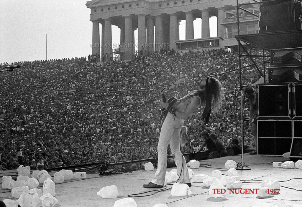"""THE """"MOTOR CITY MADMAN"""", TED NUGENT, ROCKS THE CROWD AT SOLDIER FIELD IN CHICAGO AMONGST THE MILKJUGS THROWN ON STAGE DURING THE """"SUPERBOWL OF ROCK"""", WHICH HE HEADLINED, ON JULY 10TH, 1977."""